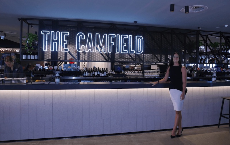 MSS IT Project Manager Harriet Mellor admires the new Camfield Bar at Optus Stadium in Perth